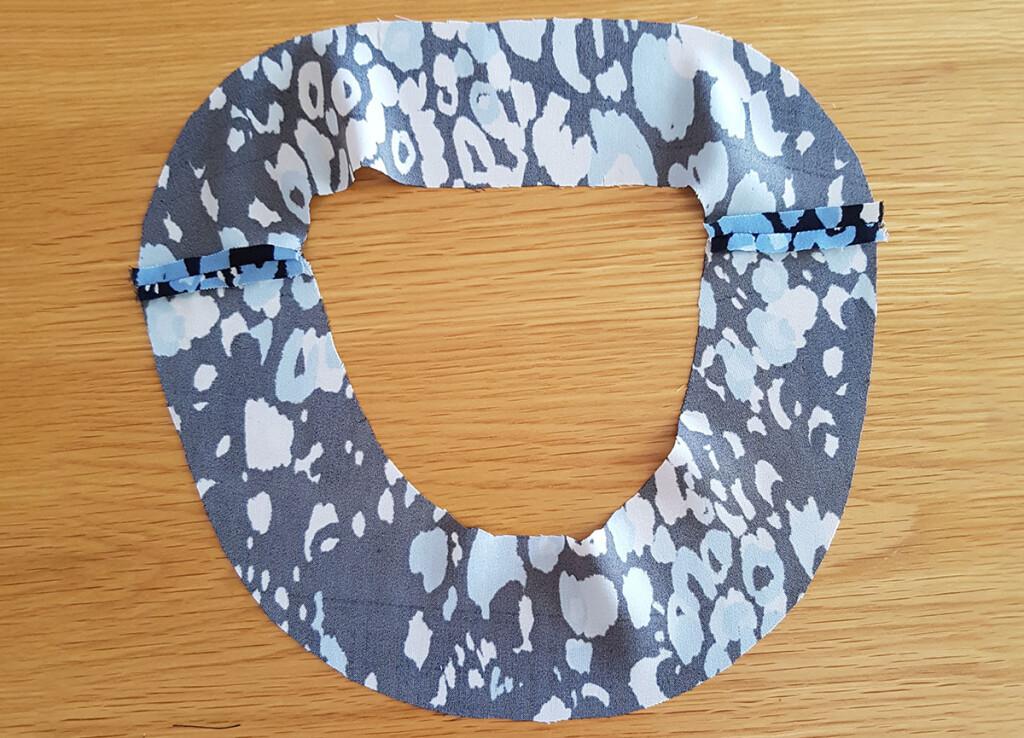 Fabric neckline facings